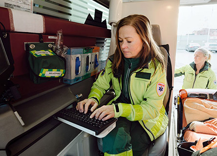 ambulance driver onboard typing on a keyboard