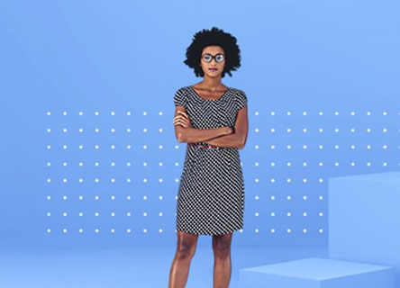 businesswoman standing confidently against a blue backdrop