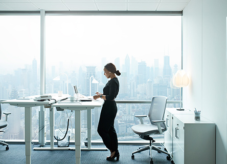woman working on a laptop in a bright modern office