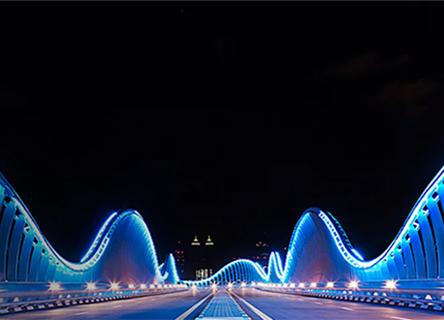 A lit up bridge at night